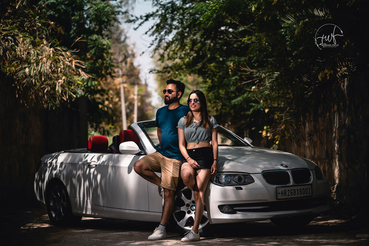 woman in blue tank top sitting on silver mercedes benz coupe unique pre-wedding photo shoot new delhi